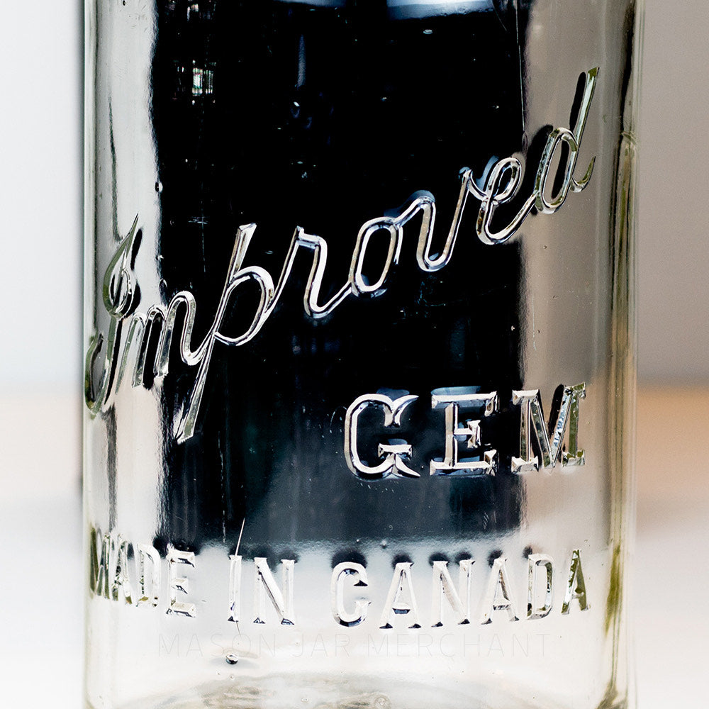Close-up of an Improved Gem logo on a half gallon mason jar