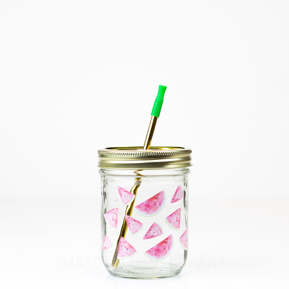 16 oz wide mouth reusable glass mason jar tumbler with a soft pink and green watercolour watermelon design and a gold stainless steel reusable straw with a green silicone tip
