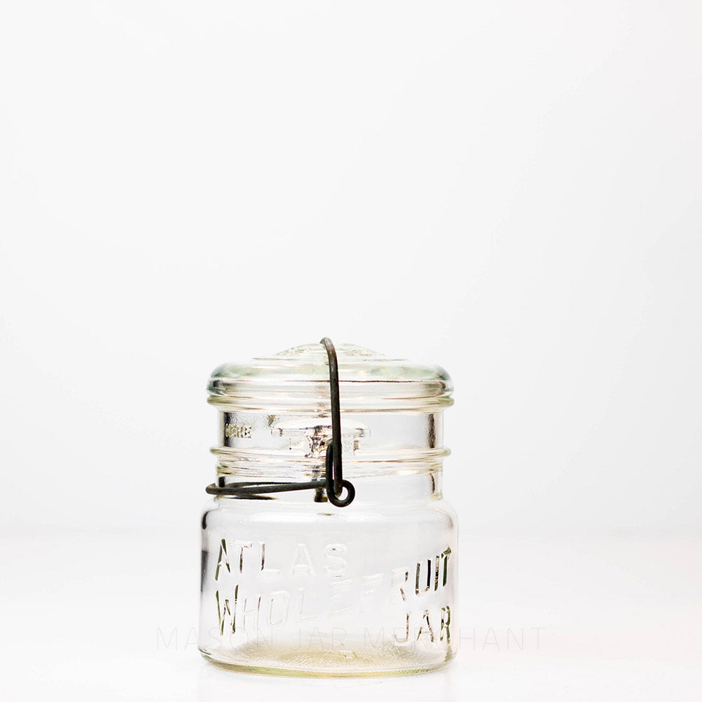 Vintage Atlas Wholefruit wide mouth wire bail mason jar against a white background
