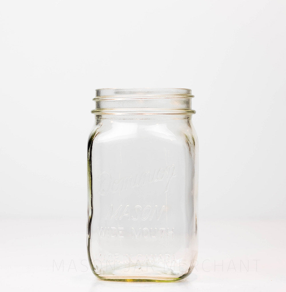 Wide mouth quart mason jar with Dominion wide mouth Mason logo, against a white background