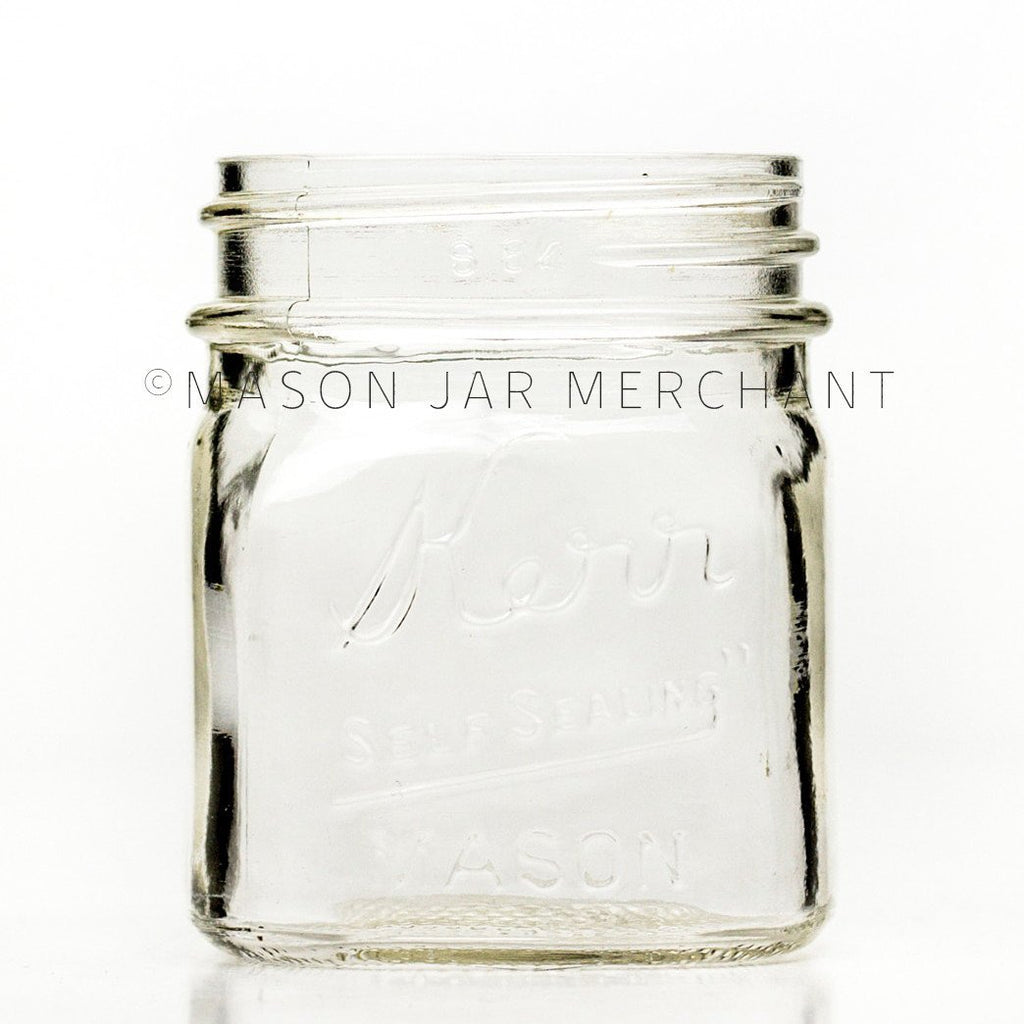 Regular mouth half-pint mason jar with square sides and Kerr self-sealing logo