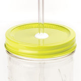 Close-up of a 24 oz mason jar with a chartreuse custom painted lid with a white silicone grommet and a glass straw, against a white background