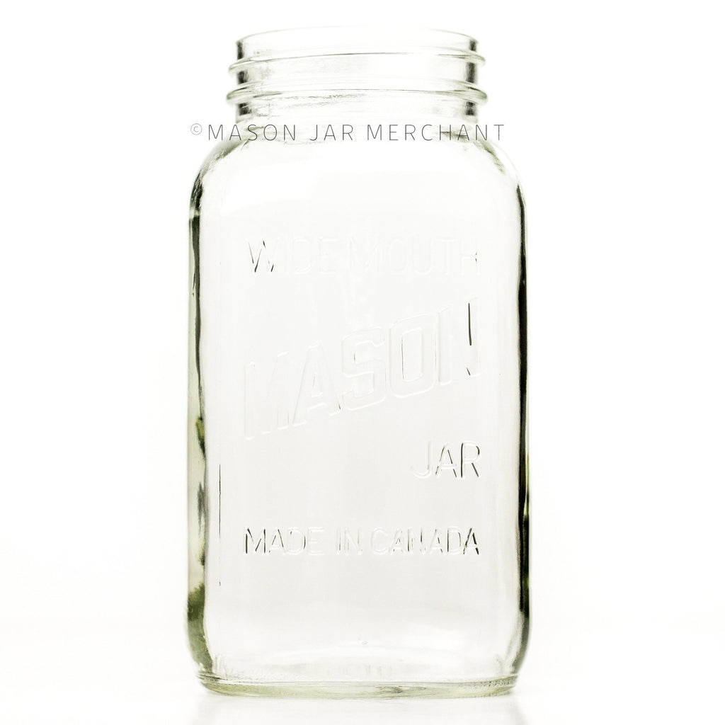 Wide mouth half-gallon mason jar with Mason logo, against a white background