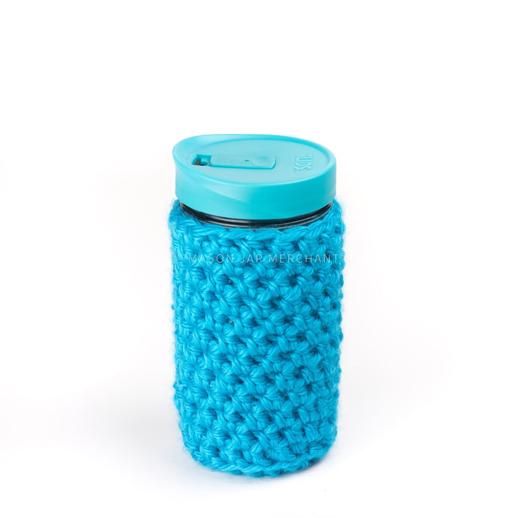 24 oz reusable glass mason jar tumbler with a teal sippy cup lid. A teal knit cozy covers the jar