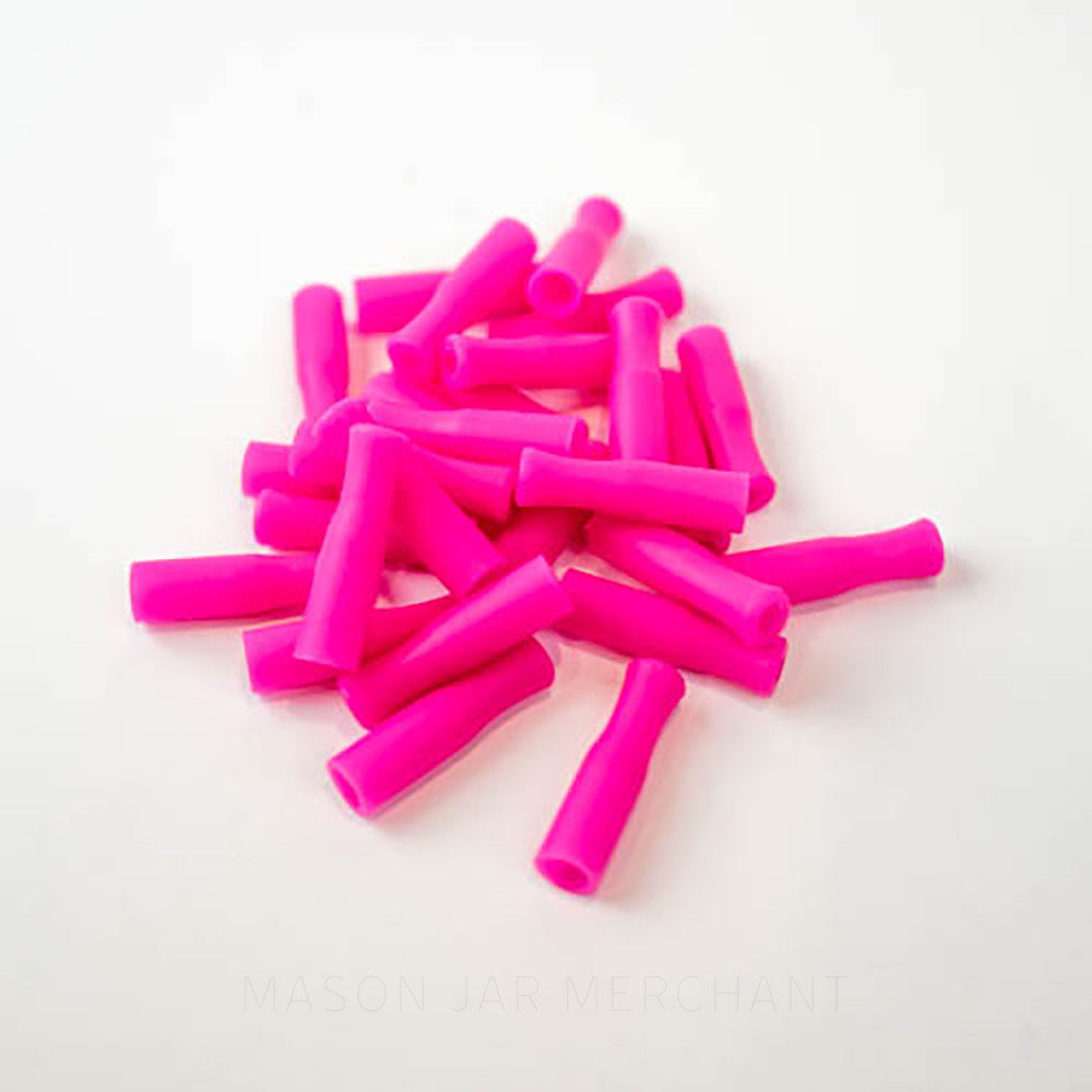 Hot pink silicone straw tips for stainless steel straws, set against a white background.
