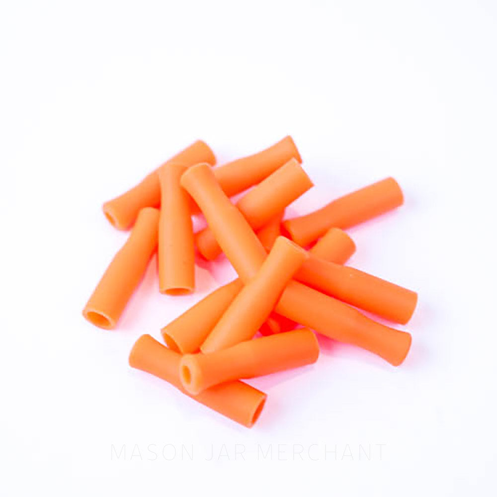 Orange silicone straw tips for stainless steel straws, set against a white background.
