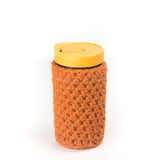 24 oz glass reusable mason jar tumbler with an orange sippy cup lid. An orange knit cozy covers the jar