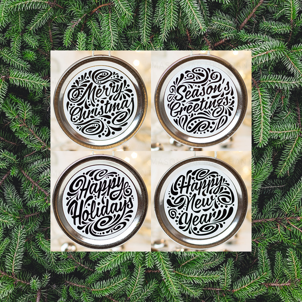 Set of 4 silver mason jar lid Christmas ornaments with black text and black curly queues. In the background are pine tree needle branches