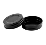 two solid black mason jar lids on a white background