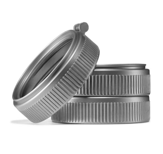 Close up of three mason jar plastic grey rings on a white background