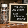 mason jar full of reusable straws next to a letterboard