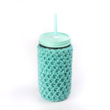 24 oz glass reusable mason jar tumbler with an all aqua painted straw lid and a aqua and white gingham straw. An aqua knit cozy covers the jar