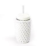 24 oz glass reusable mason jar tumbler with an all white straw lid and a glass reusable straw. A white knit cozy covers the jar