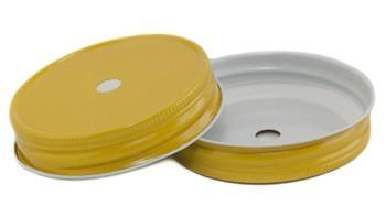 Close up of two yellow one piece wide mouth straw lids on a white background