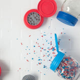 Two mason jar with Jarware flip cap lids showing off the shaker inserts with sprinkles against a white background