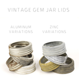 stack of four vintage aluminum GEM mouth mason jar rings next to a stack of four zinc vintage GEM mouth mason jar rings on a white background