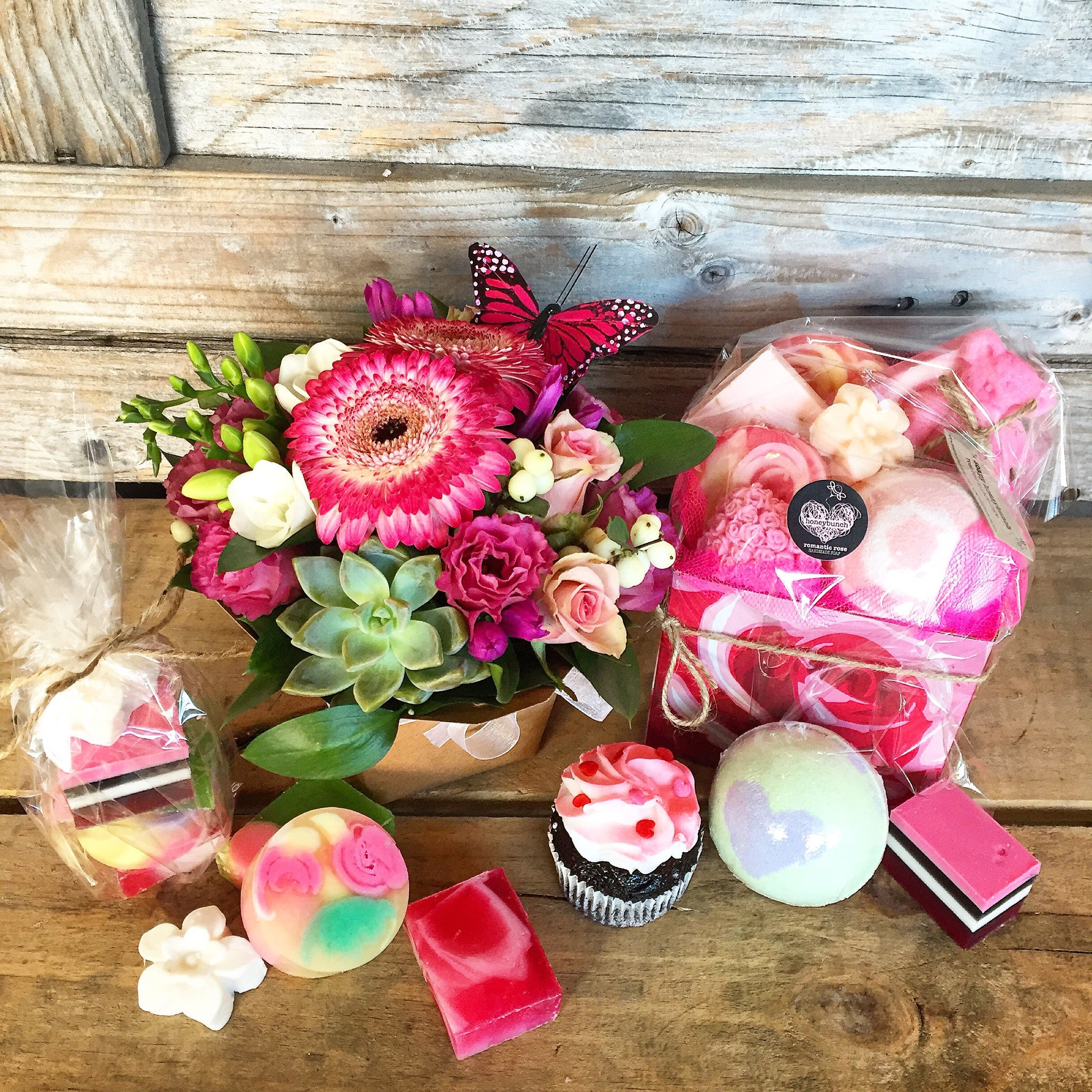 Deluxe gift pack flowers soaps and a cupcake
