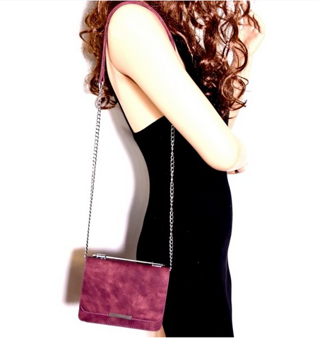 products/Wine_Crossbody_Bag-Model_Holding.PNG