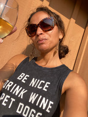 Terry Fasano the artist toasting you with a glass of chardonnay wearing change for good earrings