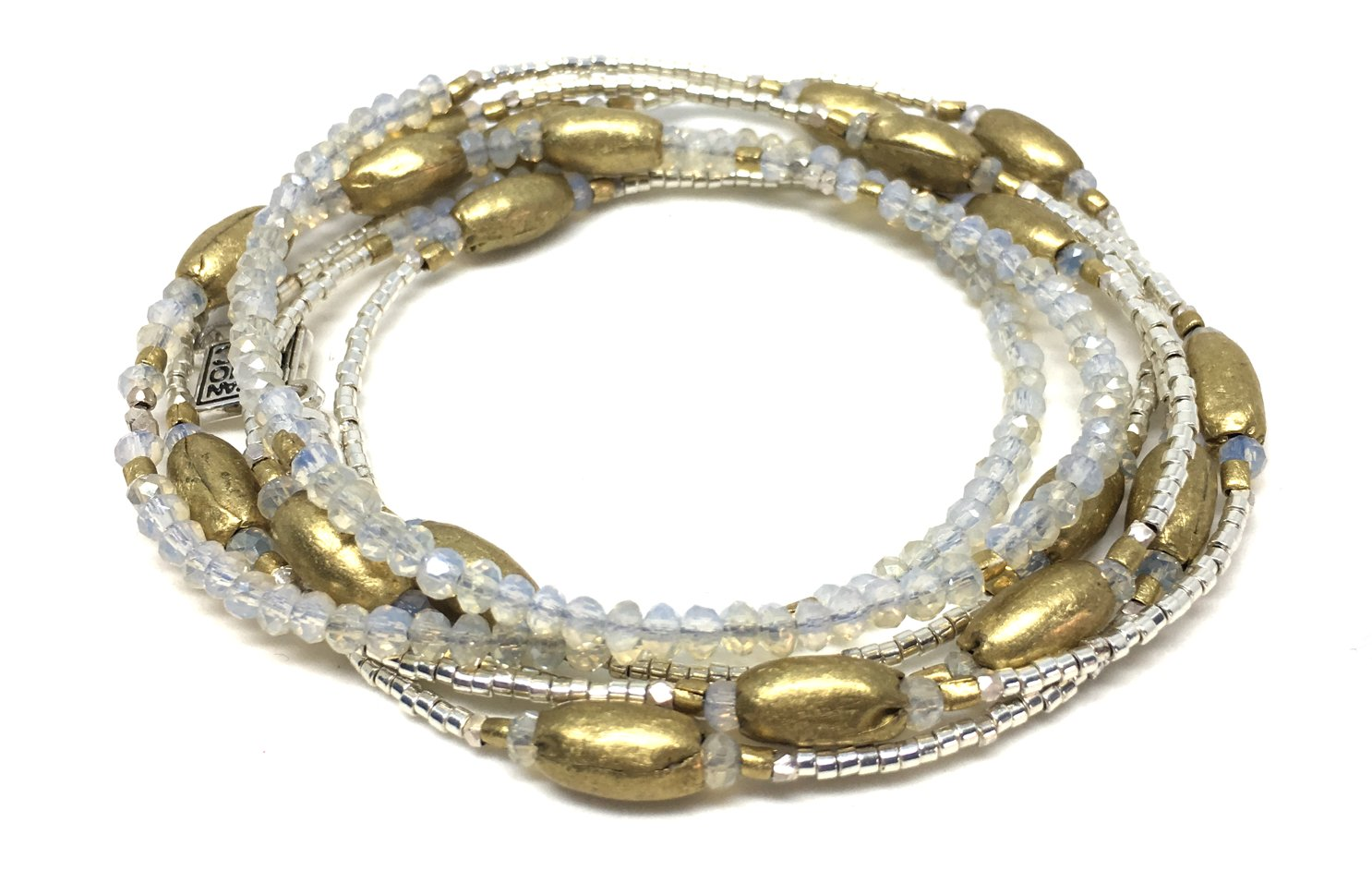 Handmade brass beads, Ethiopia  -Fine Silver handmade by the Karen Hill Tribe, Thailand  -Sterling Silver Plated Glass from Japan  -Glittering glass crystals from China