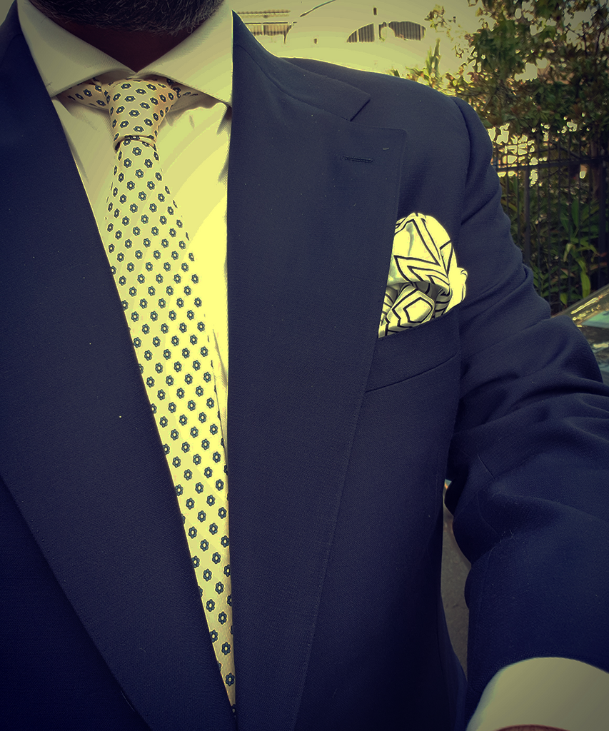 A Cream Tie On A Navy Suit Is Super Elegant
