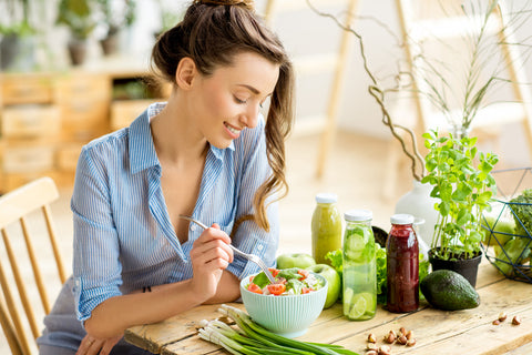 Woman eating a salad - Vitamin D Deficiency: Causes and Remedies