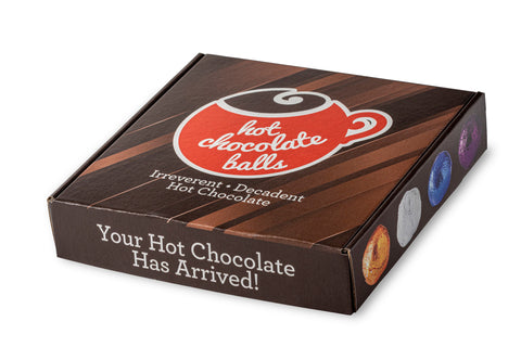 Front of box that says Hot Chocolate Balls, Irreverent and Decadent hot chocolate
