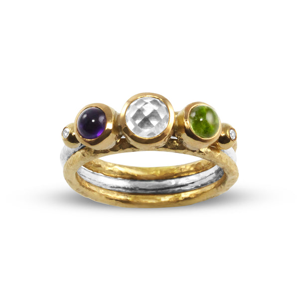 Handmade ring in 18ct and silver set blue topaz amethyst and peridot.