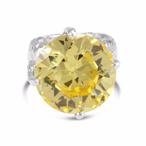 Ring handmade in sterling silver with an organic textural finish set with yellow cubic zirconia. - Paul Magen