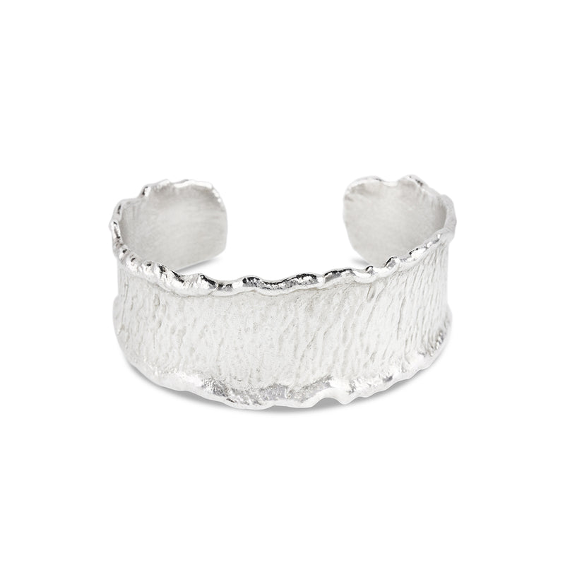 Cuff handcrafted in sterling silver with reticulated edges.
