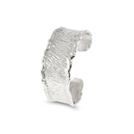 Cuff handcrafted in sterling silver with reticulated edges. - Paul Magen