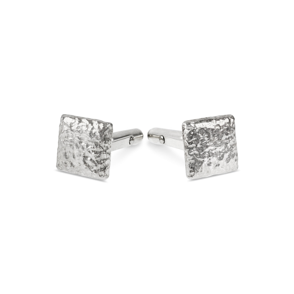 Cufflinks handmade in sterling silver with a rustic texture. - Paul Magen