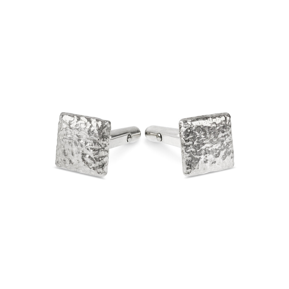 Cufflinks handmade in silver with a rustic texture.