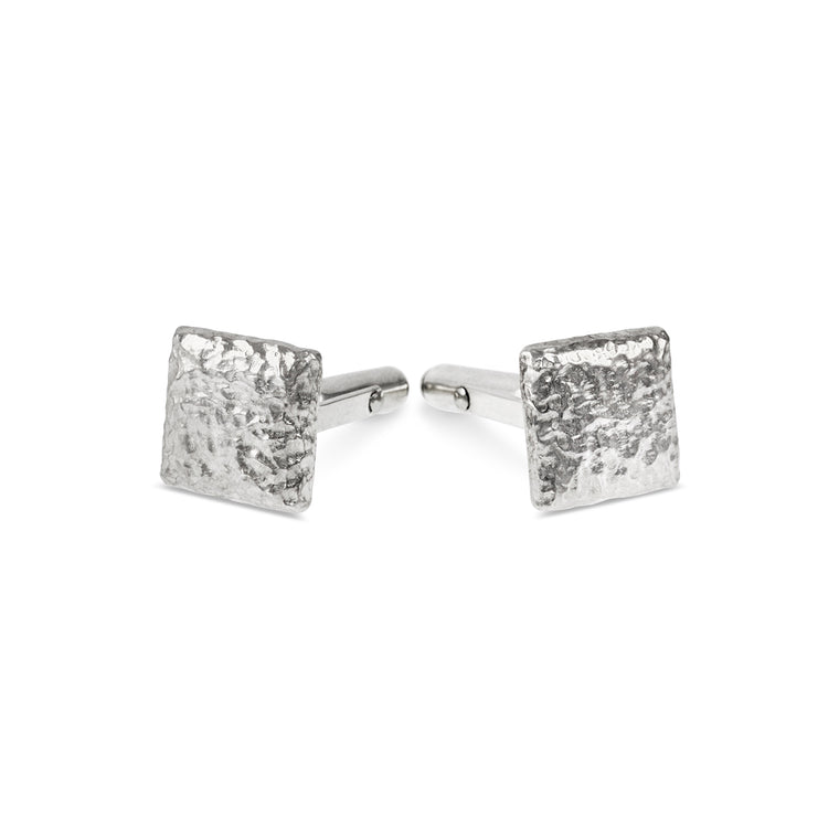 Cufflinks handmade in sterling silver with a rustic texture.