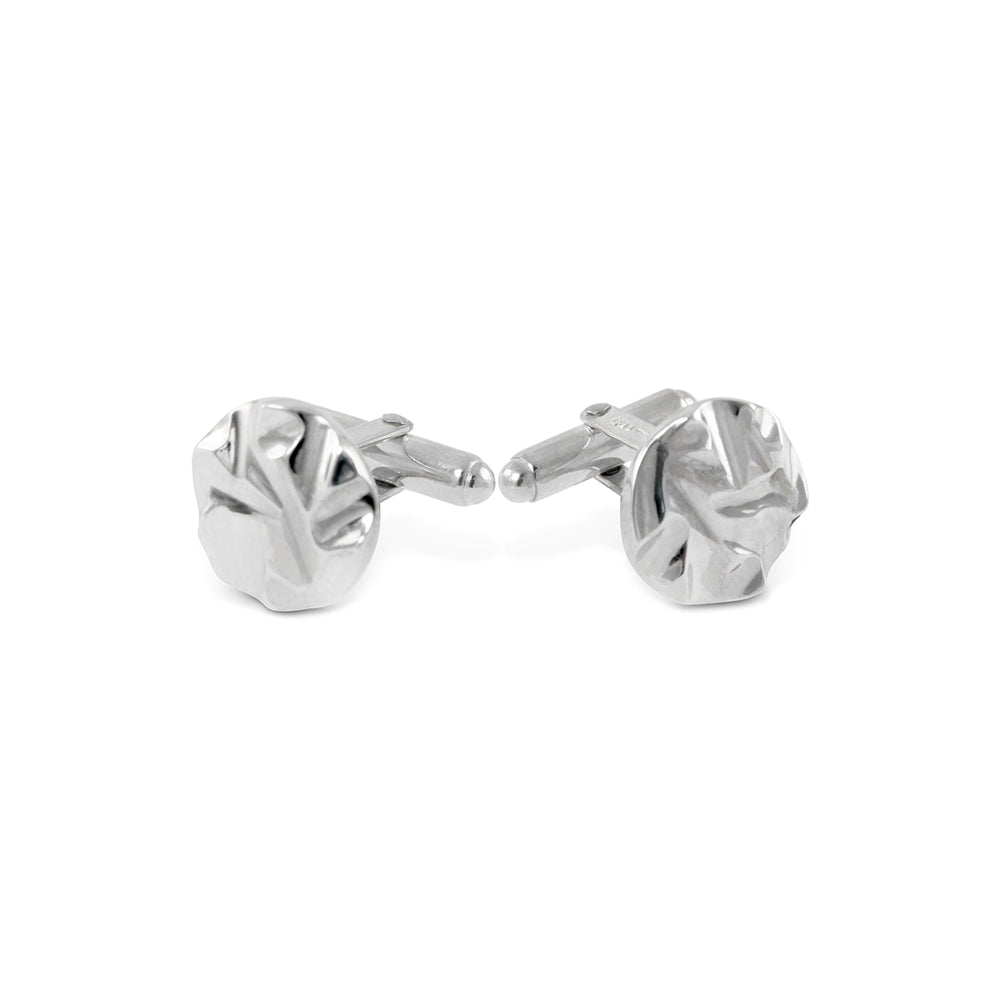 Handmade cufflinks in silver with a textured pattern.