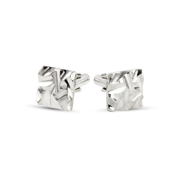 Unique handmade cufflinks with a carved pattern in silver. - Paul Magen