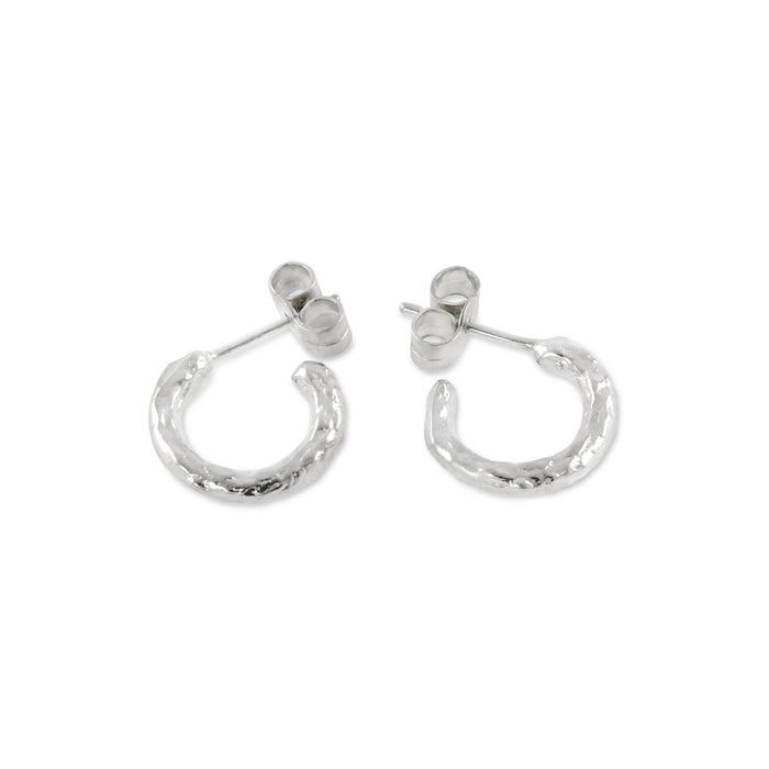 Contemporary hand textured hoop earrings made in sterling silver. - Paul Magen