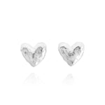 Heart shaped silver stud earrings. - Paul Magen