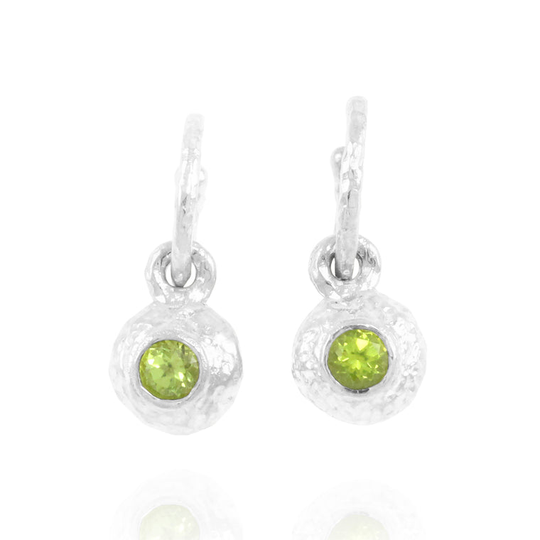 Silver earrings set with peridot gemstones.