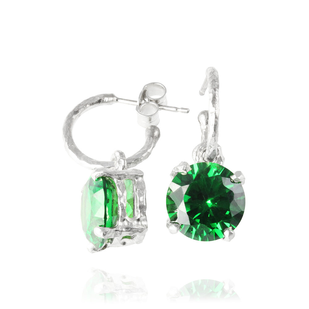 Earring in silver on hoop set  with green cubic zirconia.