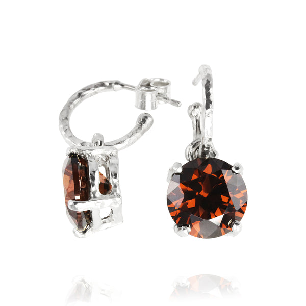 Drop earring in silver set with red cubic zirconia. - Paul Magen