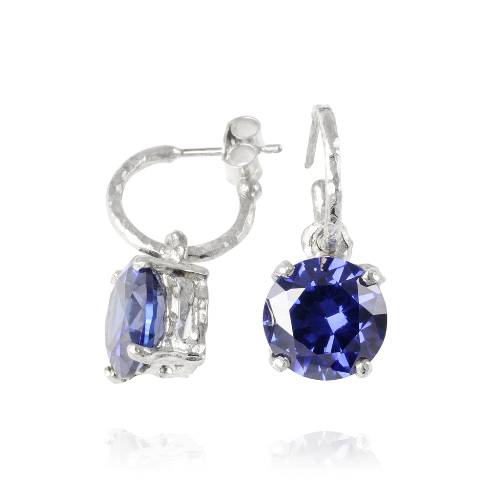 Drop earring in silver set with blue cubic zirconia.
