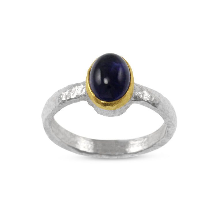 Ring handmade in sterling silver with a cabochon amethyst in a gold setting.