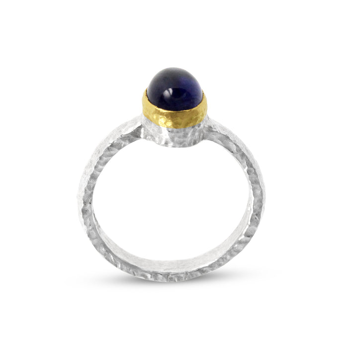Ring handmade in sterling silver with a cabochon amethyst in a gold setting. - Paul Magen