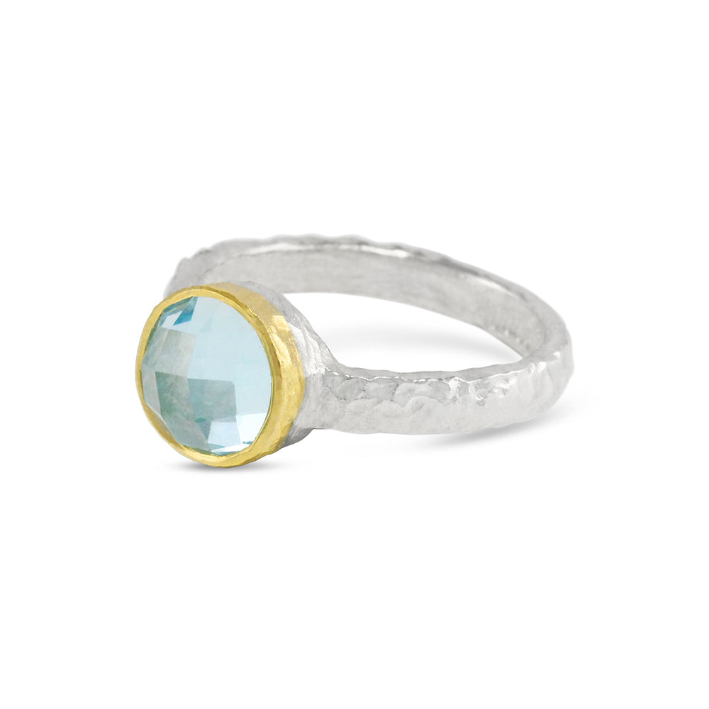 Blue topaz ring handmade in silver with 18ct yellow gold setting.