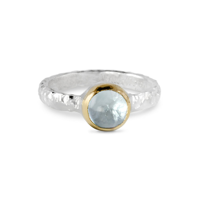 Vero ring in sterling silver with  cabochon blue topaz 8mm set in 18ct yellow gold