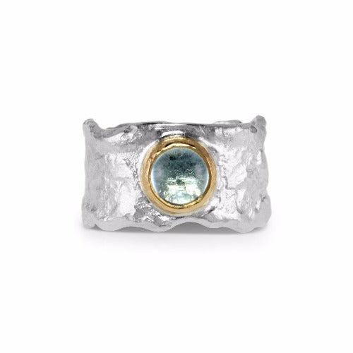 Handmade ring in sterling silver with cabochon blue topaz set in 18ct yellow gold.
