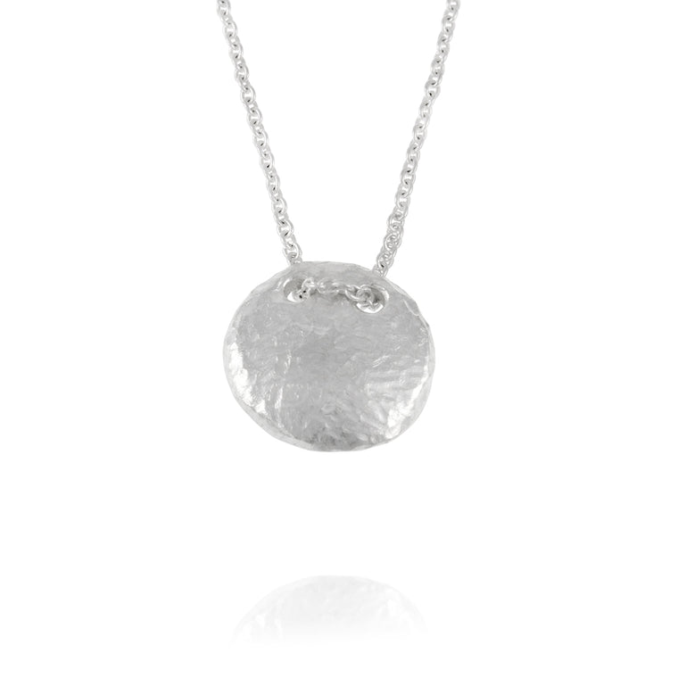 Handmade pendant with an organic texture in sterling silver on a chain.