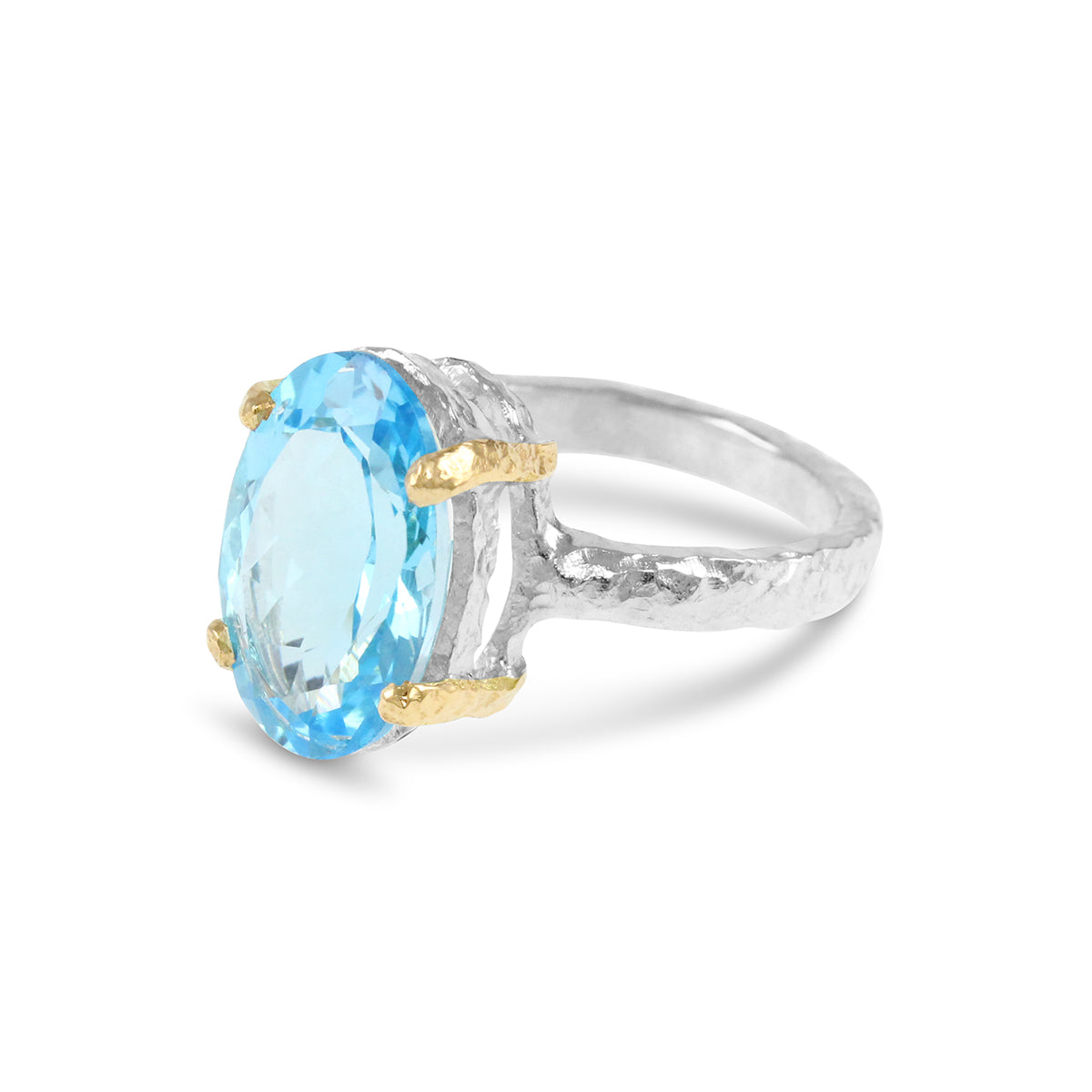 Ring handcrafted in sterling silver with 18ct yellow gold claws set with blue topaz. - Paul Magen