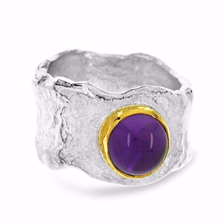 Ring handmade in sterling silver with  cabochon amethyst set in 18ct yellow gold.